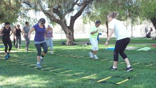 In San Fernando, Calif., kinesiology student volunteers from California State University lead a free exercise program called 100 Citizens Outdoor Fitness Program.