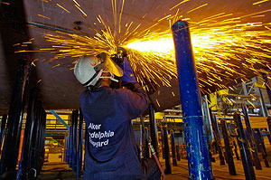 Sparks fly as work is being done on a ship under construction at  Aker Philadelphia Shipyard. (Clem Murray / Staff Photographer)