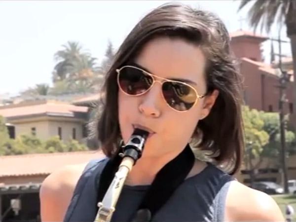 Aubrey Plaza jams on the saxophone.