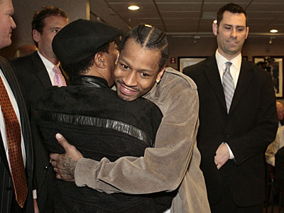 Allen Iverson hugs Sonny Hill upon arriving for his introductory press conference Thursday. (Elizabeth Robertson / Staff Photographer)