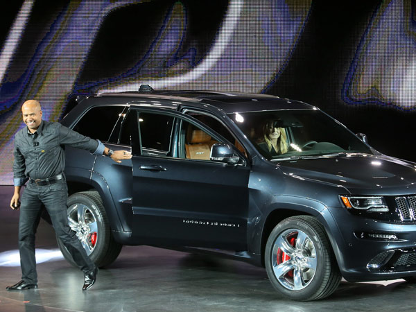 Ralph Gilles, president and CEO SRT Brand and Motorsports, announces the Jeep Grand Cherokee SRT during the 2013 North American International Auto Show at Cobo Center on Monday, January 14, 2013, in Detroit, Michigan. (Mandi Wright/Detroit Free Press/MCT)