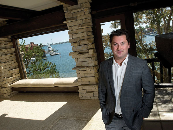 Brian Sperry, of American Coastal Properties, stands April 28, 2014 in front of the house at 86 Linda Isle in Newport Beach that the company purchased last year. The firm will redevelop the home, which has 113 feet of frontage on Newport Bay. (Paul Bersebach/Orange County Register/MCT)