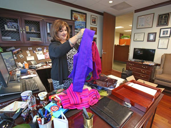 Mayanne Downs, shareholder and attorney for GrayRobinson P.A. in Orlando, sorts through items that she bought for her team and staff on a recent trip to Myanmar, formerly known as Burma. (Red Huber/Orlando Sentinel/MCT)