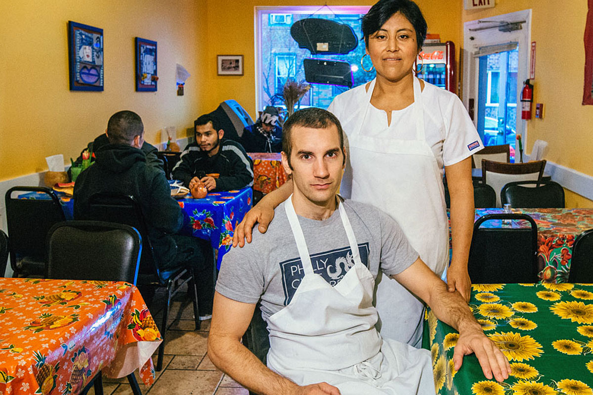Owner/chef Cristina Martinez and her co-owner husband, Ben Miller, inside South Philly Barbacoa.
