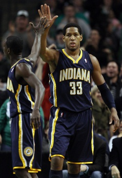 Danny Granger (33) of Pacers is congratulated by teammate Darren Collison during Indiana´s win over the Celtics on Friday in Boston. (Photo by Elsa/Getty Images)