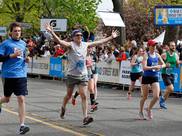 Runners cross the finish line of the 2014 Broad Street Run.