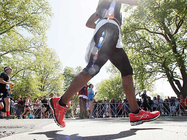 Runners enter the Navy Yard in South Philadelphia finishing the Broad Street Run on Sunday, May 5, 2013.