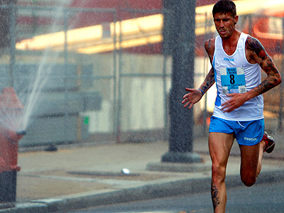 Runner Martin Fagan runs through the spray of a fire hydrant during the 32nd running of the Blue Cross Broad Street Run in Philadelphia, Pa., on May 1, 2011. (David Maialetti/Staff Photographer)