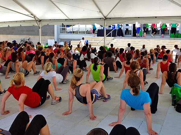 Participants work their triceps during Leslie Marant´s Body Blast Boot Camp in the Subaru outdoor fitness tent at the 2014 Be Well Philly Boot Camp.