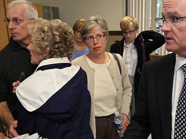 Listening to lawyer Fred Fanelli are (from left): Joe Mancini; mother Marge Yourshaw and Barbara Mancini (Michael Bryant/Staff)