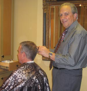 Joe Pacello&acute;s barber shop, The Men&acute;s Room, along Route 52 in Greenville, Del., is a well-known local gossip center.  Joe Biden has been coming there for 30 years, said Pacello.<br />