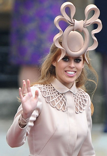 Princess Beatrice makes an eye-popping entrance at Westminster Abbey.