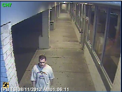 "Police are looking for this man, seen in surveillance from a burglarly of a beer store in Trevose wearing a ""Property of Jesus"" T-shirt, in connection with at least there burglaries in Philadelphia and Bucks County. (Photo: Lower Southampton Police)"