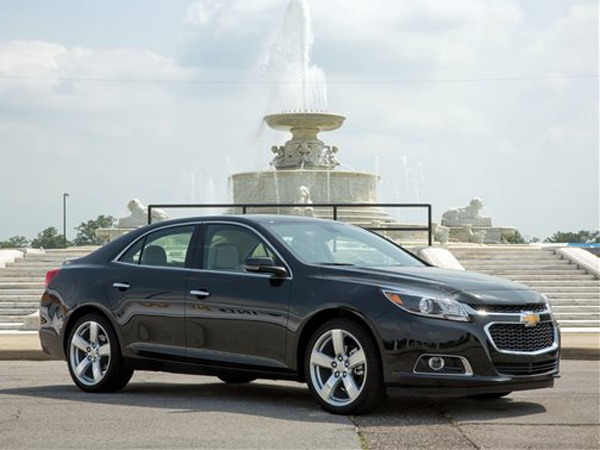 This May 31, 2013, photo provided by General Motors shows the 2014 Chevrolet Malibu in Detroit, Mich. The four-door 2014 Malibu can deliver 14 percent better mileage in city driving, in particular, than last year's Malibu, according to Chevrolet. (AP Photo/General Motors, John F. Martin)