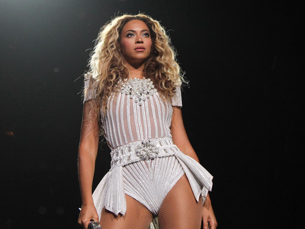 "Singer Beyonce performs on her ""Mrs. Carter Show World Tour 2013"", on Wednesday, July 17, 2013 at the United Center in Chicago, Illinois. (Photo by Robin Harper/Invision for Parkwood Entertainment/AP Images)"