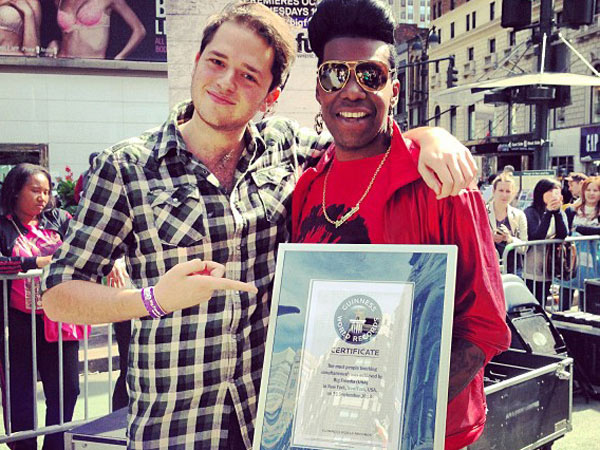 A fan with Big Freedia (right) holding the Guinness World Record certificate. (Photo via Instagram: @omri_rawrlan)