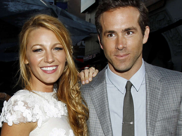 "This June 15, 2011 file photo shows actors Blake Lively, left, and Ryan Reynolds at the premiere of ""Green Lantern"" in Los Angeles. Reynolds wed Blake Lively in Mount Pleasant, S.C.,  Sunday, Sept. 9, 2012, at Boone Hall Plantation, according to a person familiar with the ceremony who requested anonymity because they were not authorized to speak on the matter. While it´s Lively´s first marriage, Reynolds was previously married to Scarlett Johansson. Their divorce was finalized last summer after three years of marriage. Lively and Reynolds both starred in last year´s ""Green Lantern."" (AP Photo/Matt Sayles, file)"