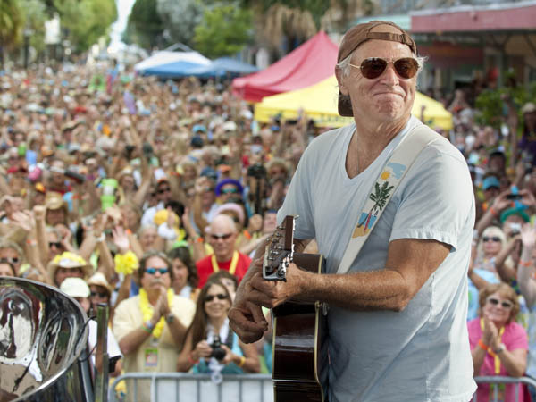 Jimmy Buffett  performs before some 3,500 of his fans on Duval Street in Key West, Fla. (AP Photo/Florida Keys News Bureau, Rob O´Neal)