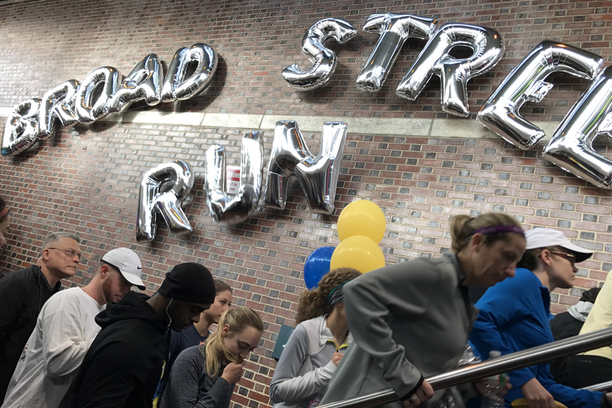 Runners participating in the 2017 Broad Street Run make their was out of Olney Station.