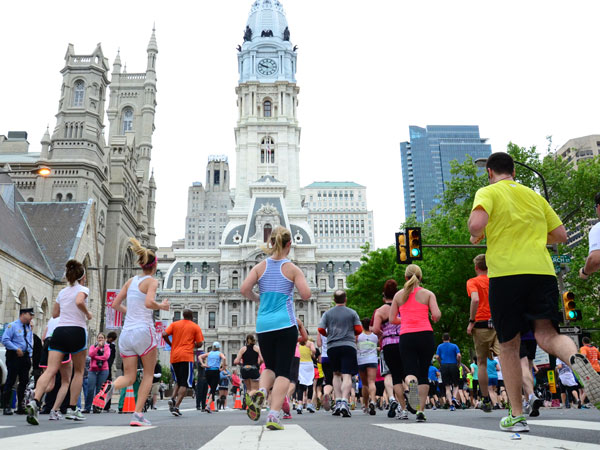 Runners race down Broad Street in the Blue Cross Broad Street Run.