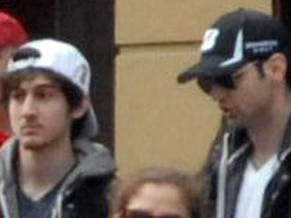 Tamerlan Tsarnaev (right) and his brother, Dzhokhar A. Tsarnaev, at the Boston Marathon in a photo taken about 20 minutes before the bomb blasts. (AP Photo/Bob Leonard)