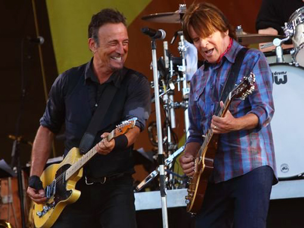 Bruce Springsteen performs with John Fogerty at the 2014 New Orleans Jazz Festival.