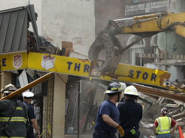 Workers knock down what remains of the Salvation Army thrift store at 22nd and Market streets. (ALEJANDRO A. ALVAREZ / STAFF PHOTOGRAPHER)