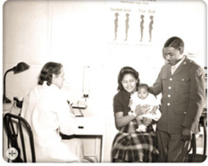 A GI and his family seeking assistance through EMIC during World War II. (National Archives)