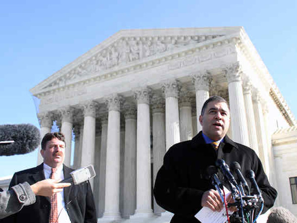 FILE PHOTO David Bossie, president of Citizens United, speaks to reporters outside the Supreme Court after the ruling involving his group.