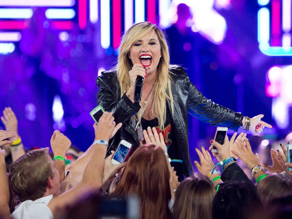 Demi Lovato performs during We Day in Toronto, on Friday Sept. 20, 2013. (AP Photo/The Canadian Press, Mark Blinch)
