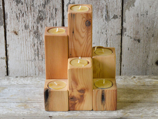 Candle blocks cut from reclaimed pine mostly from houses built in the 1800s from Peg and Awl.