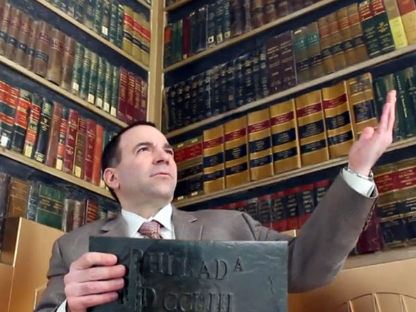 "A screengrab from judicial candidate William Ciancaglini's very entertaining YouTube promotional video. Unable to afford ""contributions"" to various committees, he decided to take to the Internet."