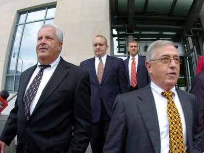 Former Luzerne County Court Judges Michael Conahan, front left, and Mark Ciavarella, front right, leave the U.S. District Courthouse in Scranton, Pa., Sept. 15, 2009, after being arraigned on federal racketeering charges. (AP Photo/The Citizens´ Voice, Mark Moran)