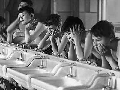 A good wash starting a day in 1940. Researchers now wonder whether exposure to bacteria might make people healthier. (AP Photo)