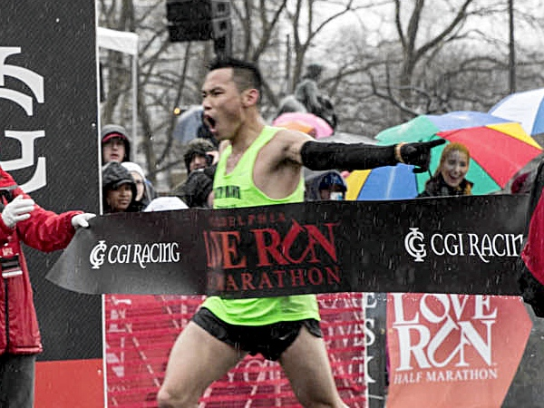 Bill Ling of Clementon, NJ won the inaugural Love Run Half Marathon in Philadelphia on Sunday, March 30, 2014. (Colin Kerrigan / Philly.com)