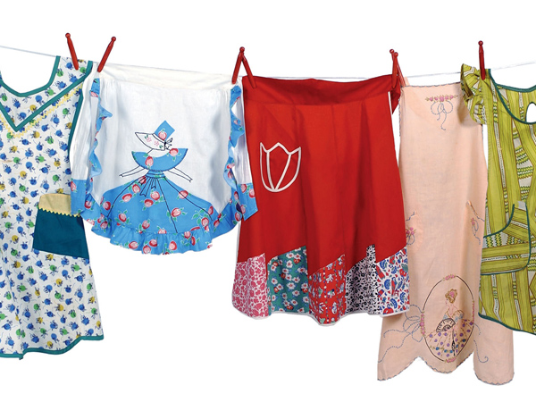 "This image released by Andrews McMeel Publishing shows vintage aprons from ""The Apron Book,"" by EllynAnne Geisel (2006, Andrews McMeel Publishing LLC). Every apron tells a story. ""When we tie on our own aprons, we in a sense bring (our loved ones) back,"" says Geisel. Despite the nostalgia of wearing an old apron, crafters still enjoy hand-making their own. (AP Photo/Andrews McMeel Publishing, Steve Bigley)"
