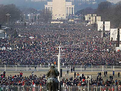 Crowds gather on the National Mall in Washington for the swearing-in<br />ceremony of President-elect Barack Obama on Tuesday, Jan. 20, 2009.<br />(AP Photo/Ron Edmonds)