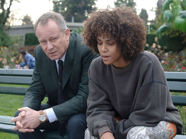 "Dr. Joseph Oswald ""Dr. Oz"" played by the incomparable Stellan Skarsgård talks with Frankie (Halle Berry) about recent discoveries."