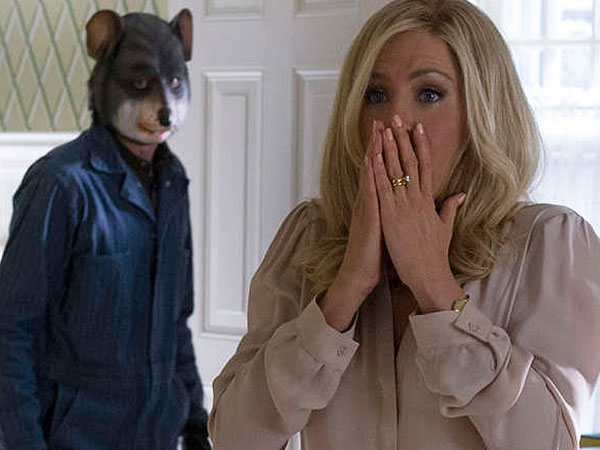 "John Hawkes as an inept kidnapper and Jennifer Aniston as the trophy-wife victim in ""Life of Crime."""