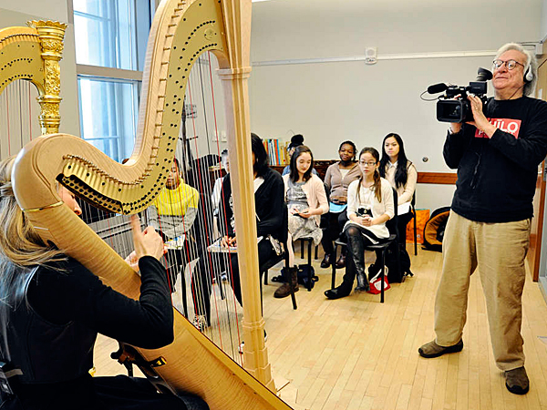 Gerald Kolpan captures a harpist for the Lyra Society. (Randi Fair/Staff Photographer)