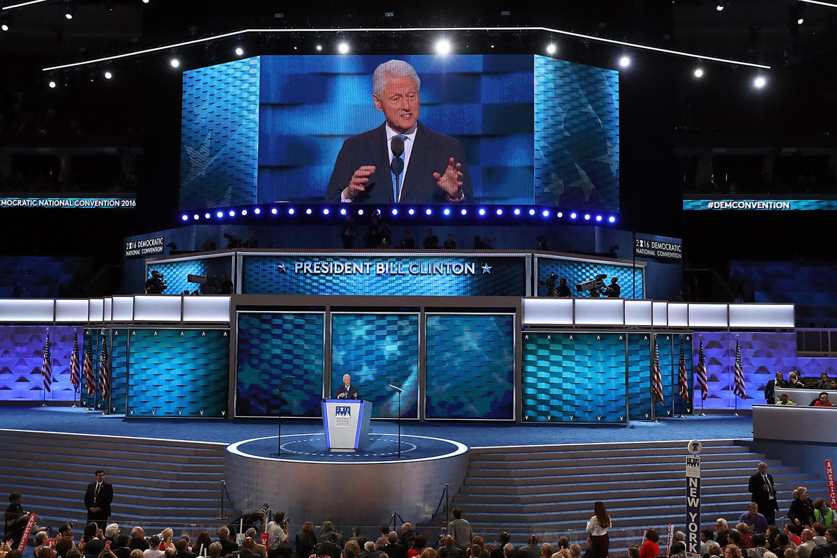 President Bill Clinton gestures while speaking to delegates during the second night of DNC at the Wells Fargo Center in South Philadelphia.