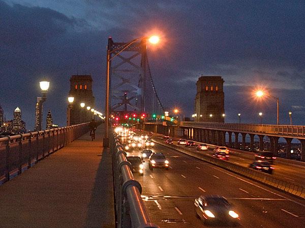 Vehicles traveling to New Jersey at dusk (headlights on left side) on the Ben Franklin Bridge. (David M Warren / Staff Photographer/File)