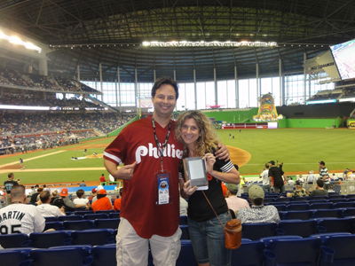My wife, karen, knows it will be a long season for her (Braves and Marlins fan), thus her Kindle. I'm sporting my Phillies best.......Kruker Jersey!