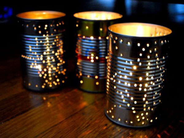 TIN CAN LANTERN - One of our most popular DIY projects of all time on Inhabitat, these surprisingly simple tin can lanterns add such lovely flair and sparkle to an al fresco event – and just in time for summer!<br />