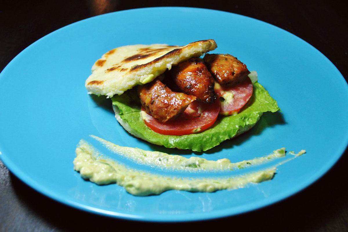 Chorizo, lettuce, and tomato arepa from Usaquen.
