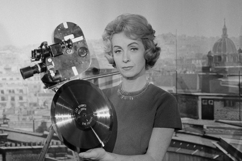 FILE - In this Dec. 27, 1959 file photo, French actress and singer Danielle Darrieux holds up a prop gold record at the Paris Saint-Maurice studios. Darrieux, a prolific French actress whose movie and theater career spanned eight decades, has died. She was 100.