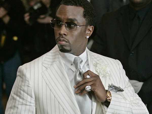 P. Diddy adjusts his tie as he arrives at the Costume Institute Gala held at the Metropolitan Museum of Art in New York, Monday, May 2, 2005. (AP Photo/Stuart Ramson)