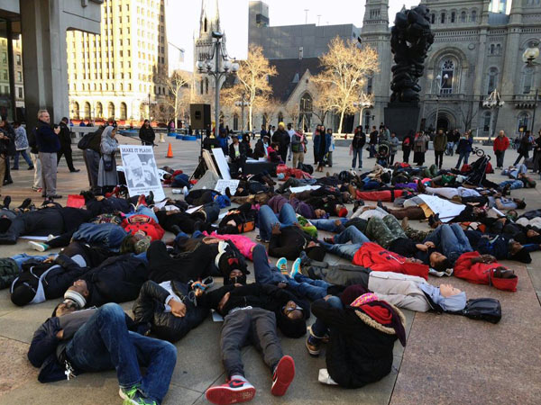 "A ""die in"" on Saturday, Dec. 27, 2014, during a rally organized by Muslims Mobilized Against Police Brutality."