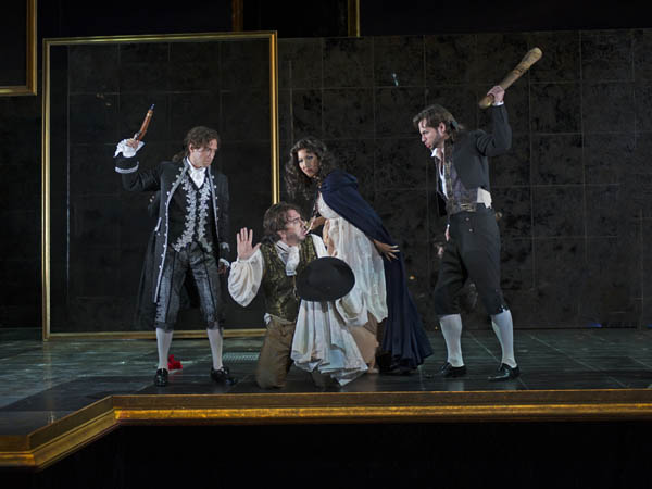 Don Ottavio (Aaron Blake), Donna Elvira (Nicole Cabell), and Masetto <br />(Ryan Kuster) threaten revenge on Leporello (Burak Bilgili), who they <br />believe is Don Giovanni, in the 2013 production of Don Giovanni at <br />Cincinnati Opera. The Philadelphia production opens Friday, April 25 at the Academy of Music.