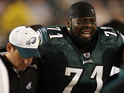 Eagles left tackle Jason Peters is helped off the field last season. (Yong Kim / Staff Photographer)